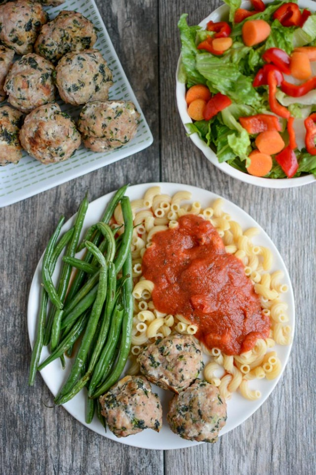 Adding vegetables to childhood and family favorites is a great way to ensure you meet your daily 4-6 servings. Meatballs made with ground turkey/chicken will be leaner and can easily become dried out. The addition of feta not only gives them another layer of flavor, but also, some fat to help keep them moist.